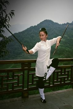 A Taoist nun practicing a type of Wudang Sword Forms - Wudang Mountains, China - taichicrossroads.blogspot.com #TaiChi #Taijiquan