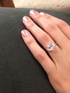 Rose gold engagement ring with oval diamond