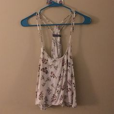 Brandy Melville double strapped floral tank lightly worn tank, slightly cropped and has double straps. Will fit xsmall-small Brandy Melville Tops Tank Tops