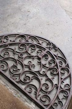 Cast iron door mat - they look really nice when weathered.
