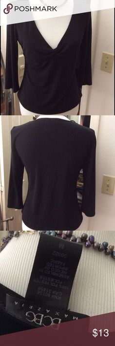✨BCBG Black Top ✨ BCBG Black Top in great condition like NEW. 3/4 length arms. Has a knitted design in the front. Super cute to dress up or down with jeans. BCBGMaxAzria Tops