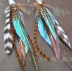 im not much on the feather earrings anymore but i think i could use these!!