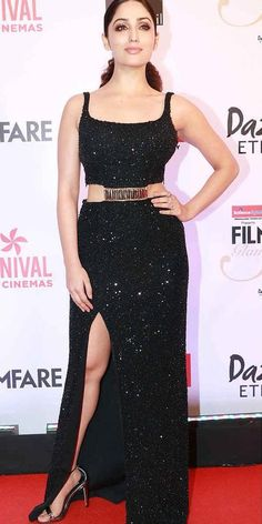 Yami Gautam in a shimmery thigh high slit gown. Shop this look on Huew.