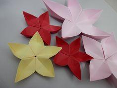 Como fazer flor de cerejeira - sakura de origami. Veja também o vídeo do outro modelinho dessa mesma flor https://www.youtube.com/watch?v=8VMQAw-yLaU Visite ...
