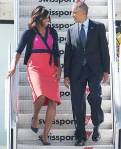 Michelle Obama's Best Looks Ever - 2014 - Diane von Furstenberg from #InStyle | The First Lady wore a colorful navy, fuchsia, and coral DVF wrap dress as she traveled with President Barack Obama via Air Force One to New York City, where the president addressed the United Nations General Assembly.