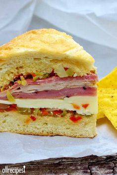 Real N'awlins Muffuletta ~ A homemade olive salad is spread on fresh bread which is then layered with salami, ham, mortadella, mozzarella and Provolone. Great sandwich, anyone? Note: Use round bread loaves for real muffuletta. Muffuletta Recipe, Muffuletta Sandwich, Mortadella Sandwich, Desserts Français, Good Food, Yummy Food, Comida Latina, Fresh Bread, Sandwich Recipes