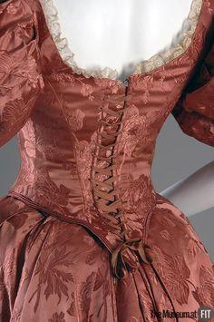 Persimmon silk satin and ecru lace evening dress. 1890s.