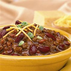 Weeknight Chili: 1 pound ground beef or ground turkey 2 cans (8 ounces each) tomato sauce 1 can (15 ounce) red kidney beans, undrained 1 package McCormick® Original Chili Seasoning Mix or McCormick® Hot Chili Seasoning Mix 1 cup shredded Cheddar cheese 1/4 cup sliced green onion
