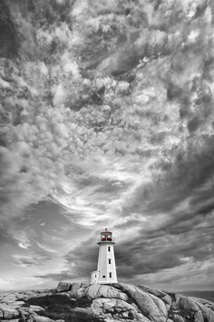 Clouds over Peggy's Cove  lighthouse, by Tony Sweet, via 500px.