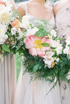 Bouquet of Coral Charm Peonies, Zinnias, Hellebores, Ranunculus, and Greenery | Brides.com
