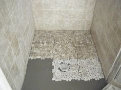 Astonishing Grey Ceramic Wall And Pebble Shower Floor Tile Inside Small Room