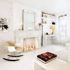 candles in the fireplace, shelving, white.