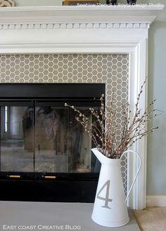 hex pattern with bee stencil. I'm thinking this would be nice to use with ardex and metallic paint on the kitchen backsplash to give a look of handmade tiles. You could also hide a bee in one spot on the backsplash. What fun! Granite Fireplace, Fireplace Tile Surround, Fireplace Update, Fireplace Remodel, Fireplace Surrounds, Fireplace Design, Paint Fireplace Tile, Mosaic Fireplace, Fireplace Doors