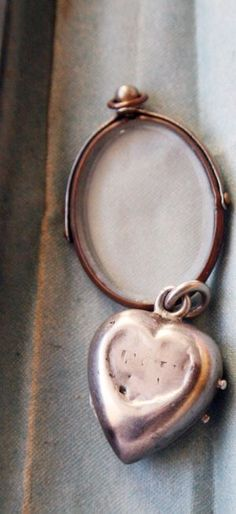 Two antique lockets side by side, full of history, yet empty.