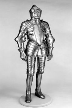 Field Armor Probably of Sir John Scudamore (1541 or 1542–1623) Armorer: Made under the direction of Jacob Halder (British, master armorer at the royal workshops at Greenwich, documented in England 1558–1608) Armorer: Helmet, left pauldron, gauntlets, and right sabaton made by Daniel Tachaux (French, 1857–1928, active in France and America) in The Metropolitan Museum of Art, Armor Workshop Date: ca. 1587, restored and completed 1915 (Steel, gold, leather)