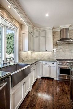 Can lights over sink! 😍 Antique white kitchen cabinets - See the before and after pictures of this farmhouse kitchen renovation with dark wood cabinets, quartz countertops and tile floors. Farmhouse Kitchen Cabinets, Modern Farmhouse Kitchens, Home Kitchens, Rustic Farmhouse, Wood Cabinets, Farmhouse Ideas, Dark Cabinets, Kitchen Rustic, Kitchen Cupboards