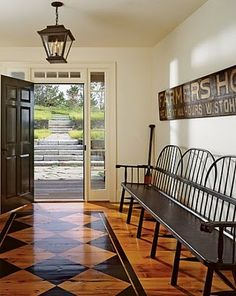 what a great entryway bench. artwork too!