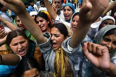 Kashmiri women protesting arrest of girl by paramilitary soldiers during a raid in Maloora - India