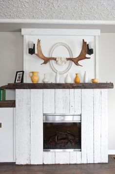 Gas Fireplace Ideas Living Room Eclectic with Antlers Dark Brown Ledge