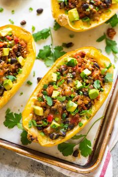 Healthy Taco Spaghetti Squash Boats stuffed with cheese, ground turkey, and black beans. An easy, filling, low carb recipe that everyone will love!