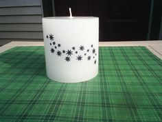 Transfer your own marker drawn art (on white tissue paper) to a candle by placing the tissue paper on the candle and then wrap it with plastic wrap. Hit with a blow dryer on low for 60 seconds and you're done!