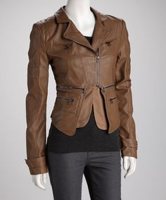 """Urban swagger is in no short supply on this tough and trendy outerwear option. Zippers galore decorate the downtown-worthy design while the unique double panel at the hem creates a sense of dimension and structure.Measurements (size S): 22"""" long from high point of shoulder to hemLined60% polyurethane / 40% cotton"""