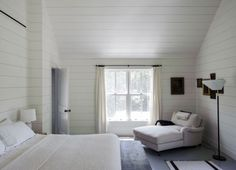 neutral country cottage bedroom with shiplap walls, furniture from mix of eras, by Finnish stylist Tiina Laakonen in the Hamptons, NY ... could add wall of bookshelves opposite bed