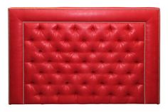Arlene Angard effortlessly blends classic and modern styles in her designs. This bold red tufted headboard is made of ultrasuede and leather. It's accented with polished silver nailhead trim.