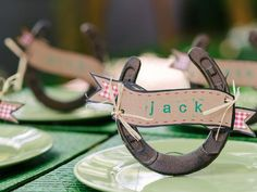 How to Make Horseshoe Place-Card Holders: To make horseshoes place-card holders, you will need: Horseshoes, craft paper, scissors, baling wire, wire snippers, needle-nose pliers, single-hole punch, twine or strands of hay, colored magic markers, tape measure, letter stampers and an ink pad. From DIYnetwork.com