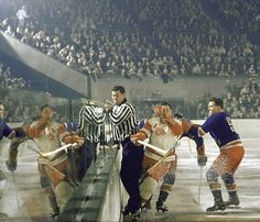 Jack Evans & Alex Delvecchio. Madison Square Garden, 1957. Combination of lighting and action make this a beautiful shot.