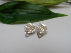 A personal favorite from my Etsy shop https://www.etsy.com/listing/244892607/flowergirl-rose-clip-on-earrings-girls