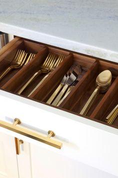 Design Manifest Petite Kitchen - white cabinet with walnut interior cutlery drawer and brass hardware.