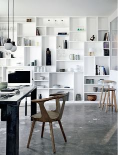 All White Bookcase Wall with Ceramics in Denmark Apartment with Concrete Walls, Remodelista