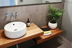 i know its a powder room?! but....... replace the basin with a bbq, lengthen the top bench, and use lower bench as storage/seating.