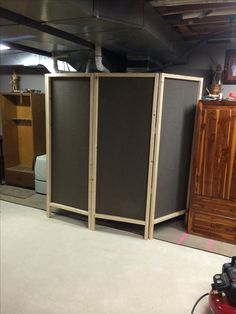 """Made this 4 panel screen to hide my furnace during a party. So easy! Made with 8 2""""x2""""x8' boards, 4 yards of fabric, nails, staples, and 6 hinges."""