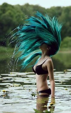 <3 Adorable photo! Wild nature, wild hair, wild spirit... So exciting and inspiring! This green hair is amazing... So beautiful colors! I LOVE so much water and forests... I don't if this is a lake or a river but this place is magical and her hair, the swimsuit, she... Everything is awesome! I feel calmness and happiness when I see this photo!