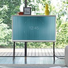 FREE STANDING Samsung Serif TV is a piece of designer furniture, and can be used as a shelf for books and trinkets