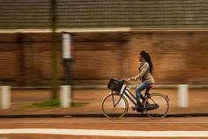 Woman with a city bike by Masis Usenmez on 500px