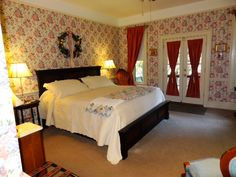 Plush Room 9.  Air jetted bath tub, private porch, gas fireplace and King Size Bed!
