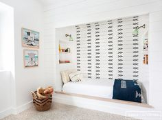 Fantastic kid's bedroom features a nook filled with a bed flanked by built-in niche bookcases illuminated by mint green sconces.