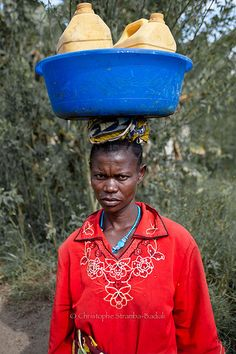 Lendu woman carrying water, Democratic Republic of Congo