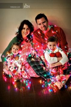 100 Photos to Inspire Your Holiday Cards - tried to wrap my husband and myself with a strand of larger light bulbs for our xmas card. We made it work but it wasn't easy. Will try mini lights next time. Does make for a cute pic, though.