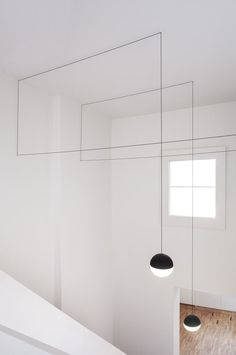 Flos, String Light.   Nice way to create a sense of decoration and form in a high ceiling room that looks slick and modern. These orbs would be even better with an 'any-color' bulb like LIFX....