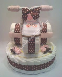 Tricycle Diaper Cake for Girl http://babyfavorsandgifts.com/diaper-cakes-baby-girl-c-3_22.html