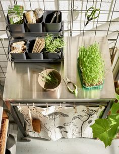Get your gardening things organized with a garden workstation made from a utility cart.