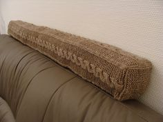 Ravelry: Cabled Door Draught Excluder pattern by SaBine Vogelpoth