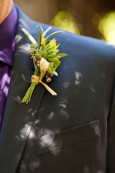 A bright green boutonniere tied with twine. Jade Turgel Photography.