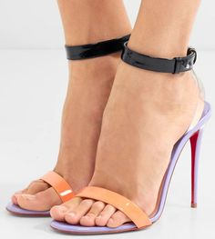 These statement heels are made from a bright combination of lilac, black and pastel-orange patent-leather, alongside the striking signature red sole