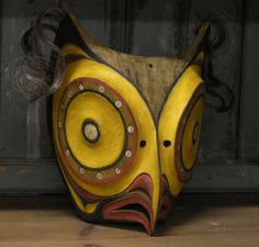Northwest Coast Native American carved cedar owl mask, polychrome decorated and inlaid with abalone buttons, human hair, first quarter to mid 20th century, 8.5'' x 8'' x 11'' h.