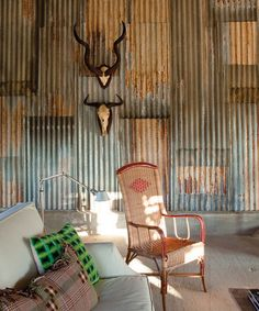 Love the oxidized corrugated wall, not really the rest of the stuff in the room